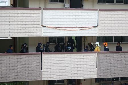 Man locks himself in Serangoon North flat, threatens to jump