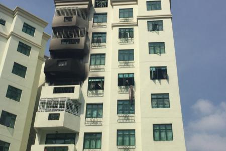 Fire at condominium traps family in bedroom