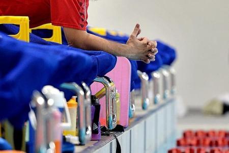 Auburn University celebrate capture of Singapore swim coach Lopez