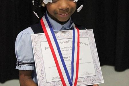 Girl, 7, without hands, wins US handwriting contest