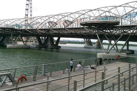 Woman found face down in Marina Bay