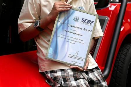 Boy, 12, who helped accident victims, gets SCDF award