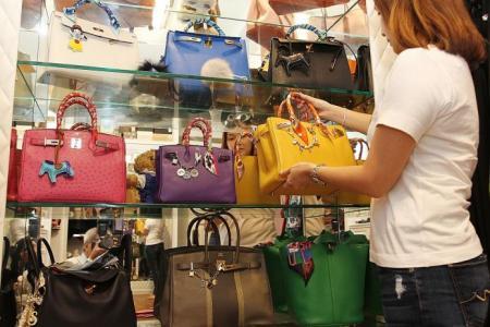 Singapore teacher blows annual bonuses on Hermes Birkin bags