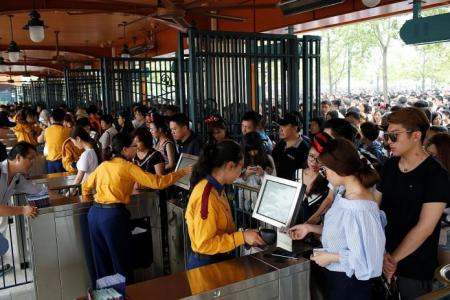 Thousands throng opening of Shanghai's Disney Resort
