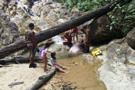 Singapore man dies trying to save daughter at Johor waterfall
