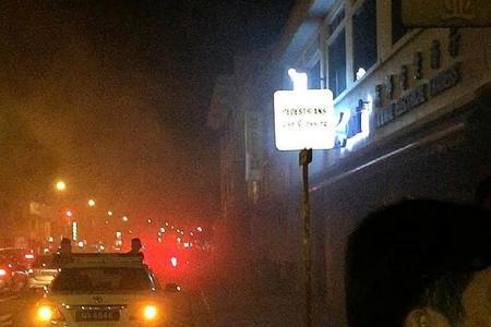 10 people flee fire in Geylang shop