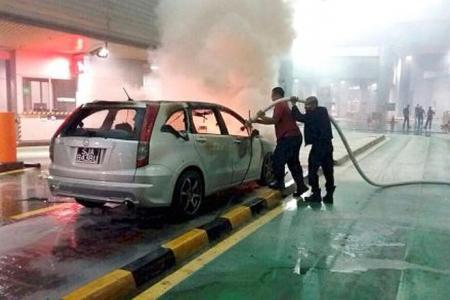 Car on fire at JB Customs