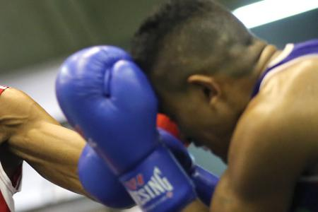 Jailed for punching his boxing coach