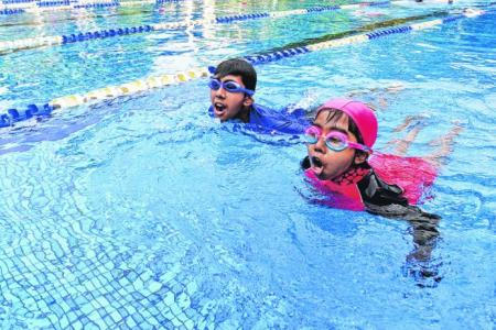 Siblings swim to raise funds for kids with kidney failure
