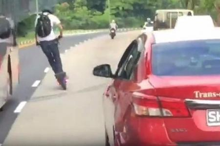 E-scooter rider dices with death by overtaking bus