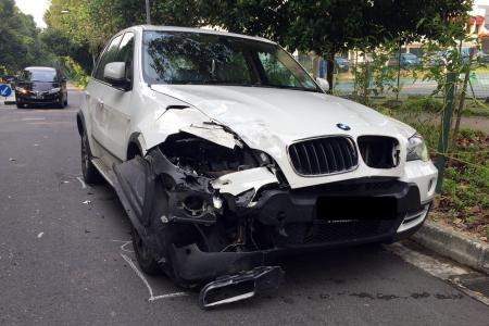 BMW smashes into back of police car