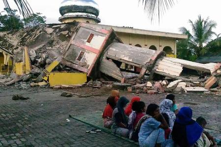 Indonesia quake kills at least 97