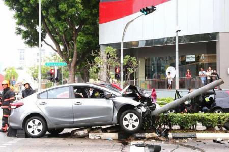 Eight hurt as car topples traffic light in Bugis