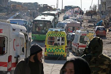 Civilian evacuations begin after ceasefire deal in Syria