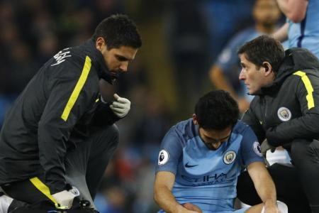 Manchester City's Ilkay Gundogan receives treatment after sustaining a injury