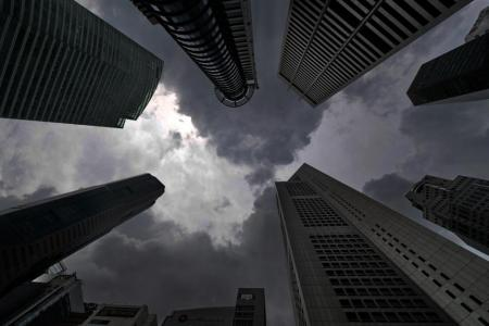 Dark clouds loom over the skyscrapers in Raffles Place