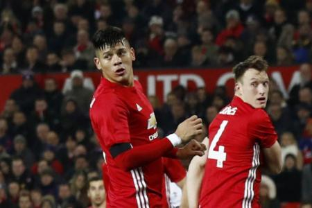 Jose Mourinho has praised Marcos Rojo and Phil Jones (above) for helping the Red Devils keep two clean sheets in their last three games.