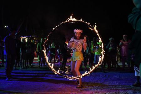 Full moon party on Koh Phangan island defies Thai troubles
