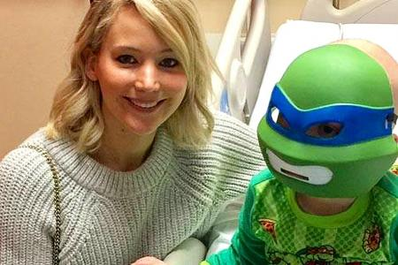 Jennifer Lawrence brings Christmas cheer to sick children