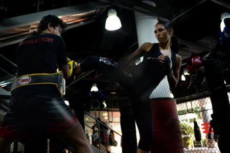 Miss Kirstie Gannaway sparring with a fellow instructor at Evolve MMA.