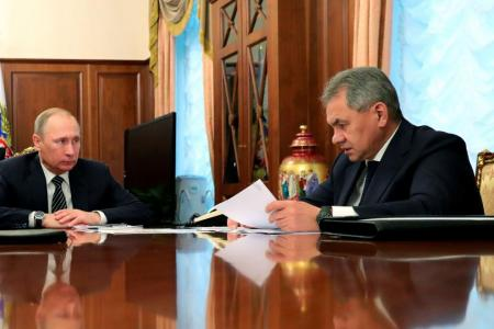 Russian President Vladimir Putin (left) meeting with Defence Minister Sergei Shoigu at the Kremlin.