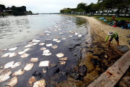 Major clean-up after oil spill spreads to Singapore beaches