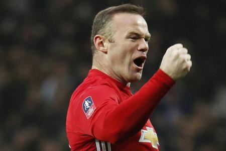Manchester United's Wayne Rooney celebrates scoring against Reading