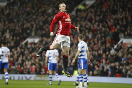 Manchester United's Wayne Rooney celebrates scoring against Reading. Rooney equalled Bobby Charlton's club scoring record of 249 goals in all competitions.