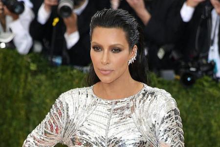 16 held over Kardashian robbery