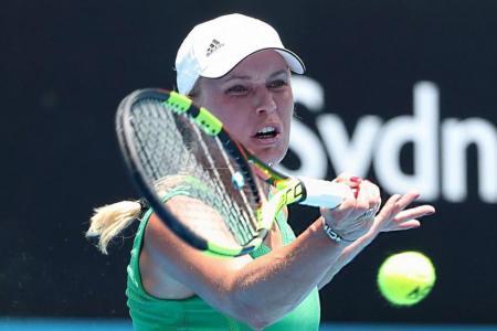 Caroline Wozniacki wilts in Sydney heat