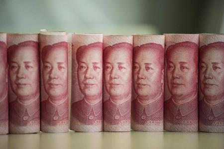China should halt yuan intervention: Economist