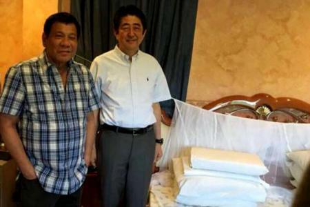Abe visits Duterte's Davao home
