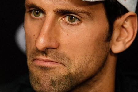 Djokovic deflects Becker jab about work-rate
