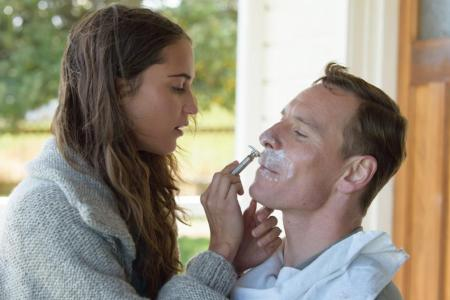 Michael Fassbender being shaved by Alcia Vikander in The Light Between Oceans