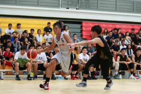 NTU (white) defeated SIM 58-46 to win the IVP Basketball Championship.