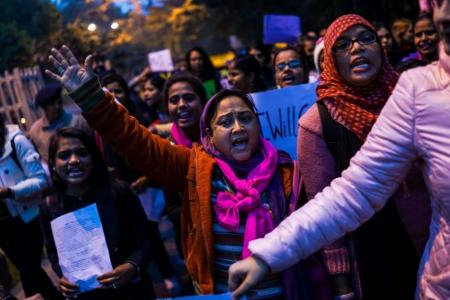 Women across India take to the streets to 'take back the night' after mass molestation