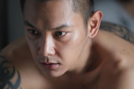 He immerses himself in ex-con role in movie Take 2