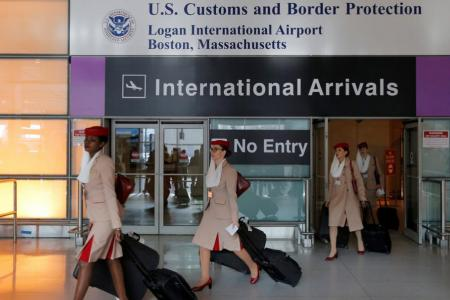 Airlines scramble to tweak crew rosters on US flights after travel ban