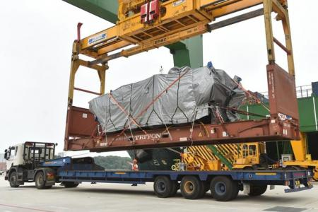 The Terrexes, seen covered in tarpaulin, about to be unloaded at PSA's Pasir Panjang terminal yesterday afternoon.