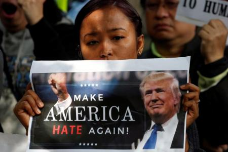 A protester against the travel ban demonstrating outside the US Consulate in Hong Kong.