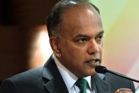 Mr K. Shanmugam speaking at the symposium.
