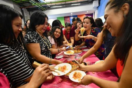 Maids get a taste of Chinese New Year