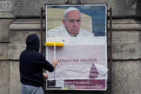 Posters criticising Pope Francis pop up in Rome