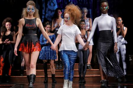 Australian model and designer Madeline Stuart, who has Down syndrome, acknowledges attendees after presenting creations from her label 21 Reasons Why By Madeline Stuart during New York Fashion Week