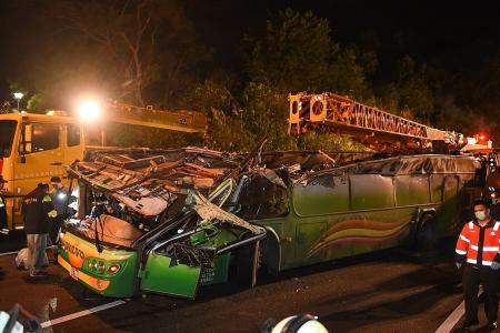 Driver in deadly Taiwan tour bus crash was overworked, says daughter