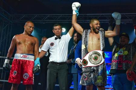 Rafi is first local male to win pro boxing title