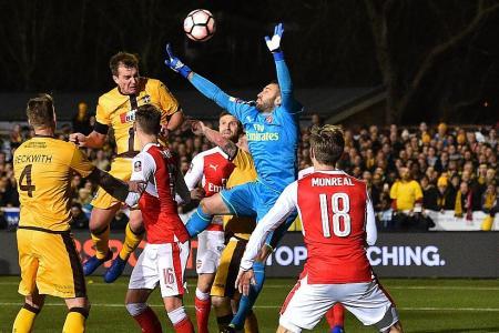 Wenger praises 'astonishing' Sutton
