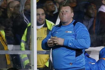 Sutton's 'roly-poly goalie' eats pie during match