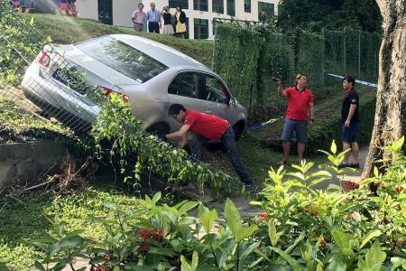 Car slides down slope at school