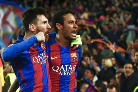 Lionel Messi  and Neymar celebrate winning the Champions League second leg round of 16 match against Paris Saint-Germain at Camp Nou stadium